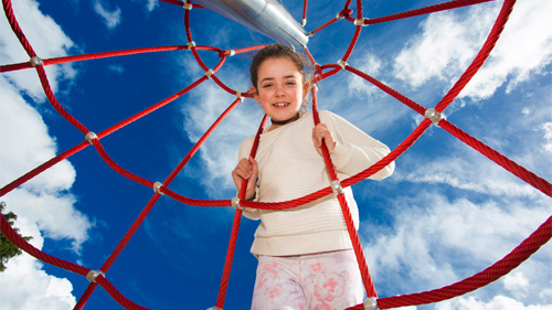 A young girl all smiles at a local recreational facility